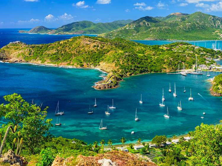 The white beach and the crystal-clear waters of Antigua on a Costa Cruise